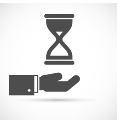 Hand holding hourglass vector