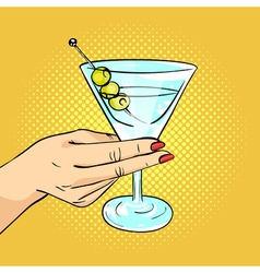 Hand drawn pop art of woman hand holding martini vector