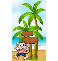 A boastful monkey at the beach near the vector image