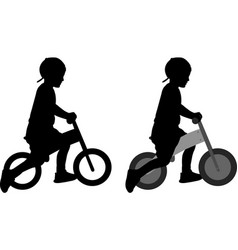 Boy riding a pushbike silhouette vector