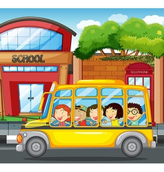 Children riding on yellow bus in town vector image