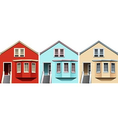 Wooden houses in different colors vector