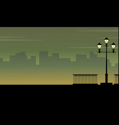 Silhouette of city background with street lamp vector