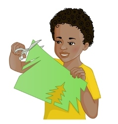 African american boy cuts paper with scissors vector