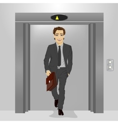 young businessman coming out of office elevator vector image