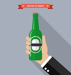 Hand holds a bottle of beer vector