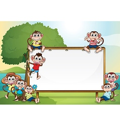 Frame design with monkeys in the park vector image vector image