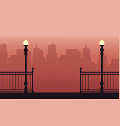 Silhouette of street lamp with fence landscape vector