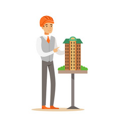 Young architect man in orange safety helmet vector