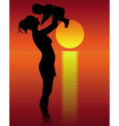 Silhouette of mother and child vector