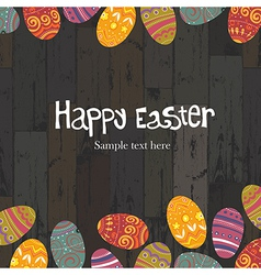 Easter eggs on wooden backround vector