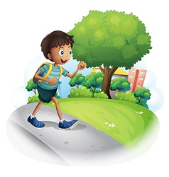 A boy with a bag walking along the street vector image vector image