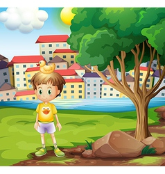 A boy with a rubber duck above his head standing vector