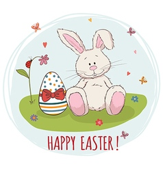 Happy easter easter bunny and egg in grass vector