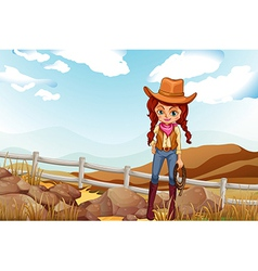 A pretty cowgirl near the rocks vector