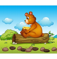 A bear sitting down on the trunk of a tree vector image vector image