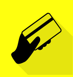Hand holding a credit card black icon with flat vector