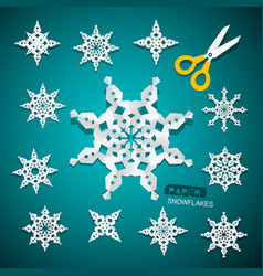 Paper cut snowflakes set with scissors on blue vector