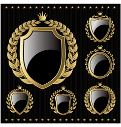 set of golden emblem with shield and wreaths vector image