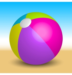 inflatable beach ball on the beach vector image