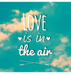 blurred with clouds sky and text Love is i vector image