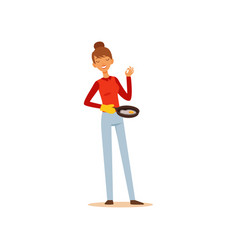 Young woman holding frying pan with fried eggs vector