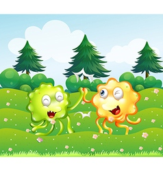 A green and an orange monster near the pine trees vector
