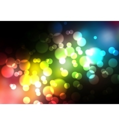 Glittering blurry lights against a black vector