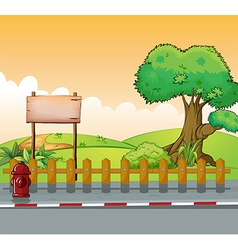 A wooden signboard and a big tree vector image