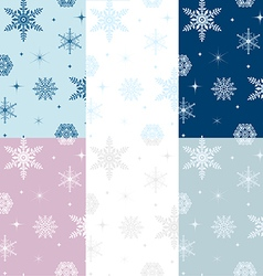 Snowflakes seamless patterns set vector image