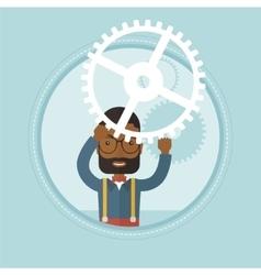 Businessman holding cogwheel above his head vector