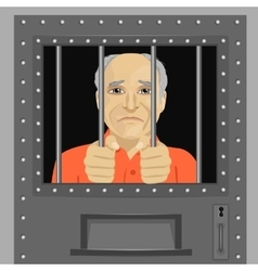 Elderly man looking from behind bars vector