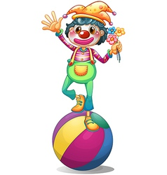 A clown balancing above a ball vector image
