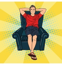 Happy man relaxing in comfortable chair pop art vector