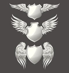 set of angelic or bird wings with heraldic vector image