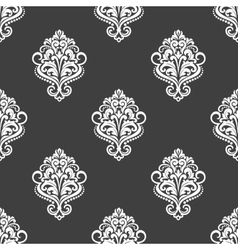 Geometric seamless pattern with floral motifs vector
