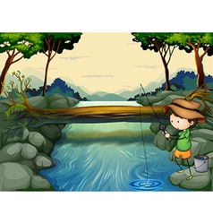 A boy fishing at the river vector image vector image