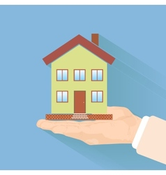 House in human hand vector image
