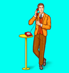 Pop art man talking on a retro phone and shows the vector