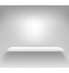 Empty white shelf hanging on a wall vector