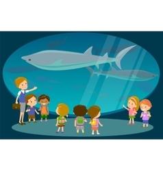 Group of kids watching sharks at oceanaruim vector