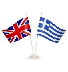 Table stand with flags of greece and us vector