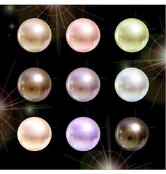 Shinyl pearls on black background set vector