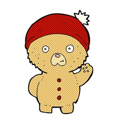 Comic cartoon waving teddy bear in winter hat vector