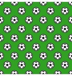 Soccer ball on green seamless background vector