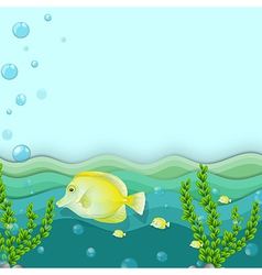 A group of yellow fishes under the sea vector