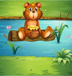 A bear sitting on a dry wood vector image vector image