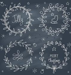 Christmas wreaths set on blackboard vector image