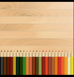 Pencils multicolored autumnal wooden background vector