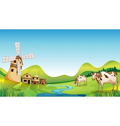 A farm with a barn and cows vector